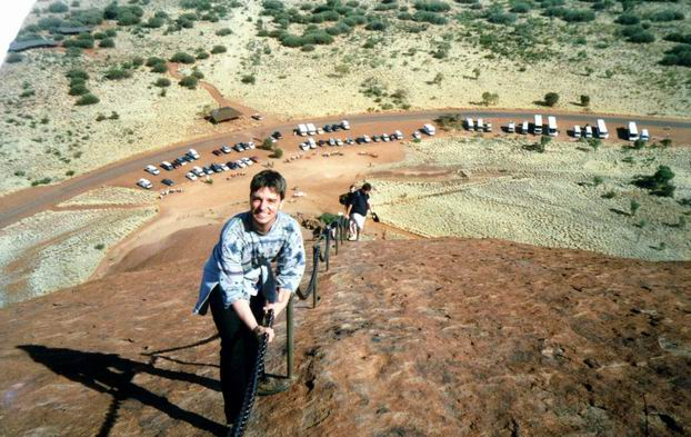 Climbing up Uluru on chain.
